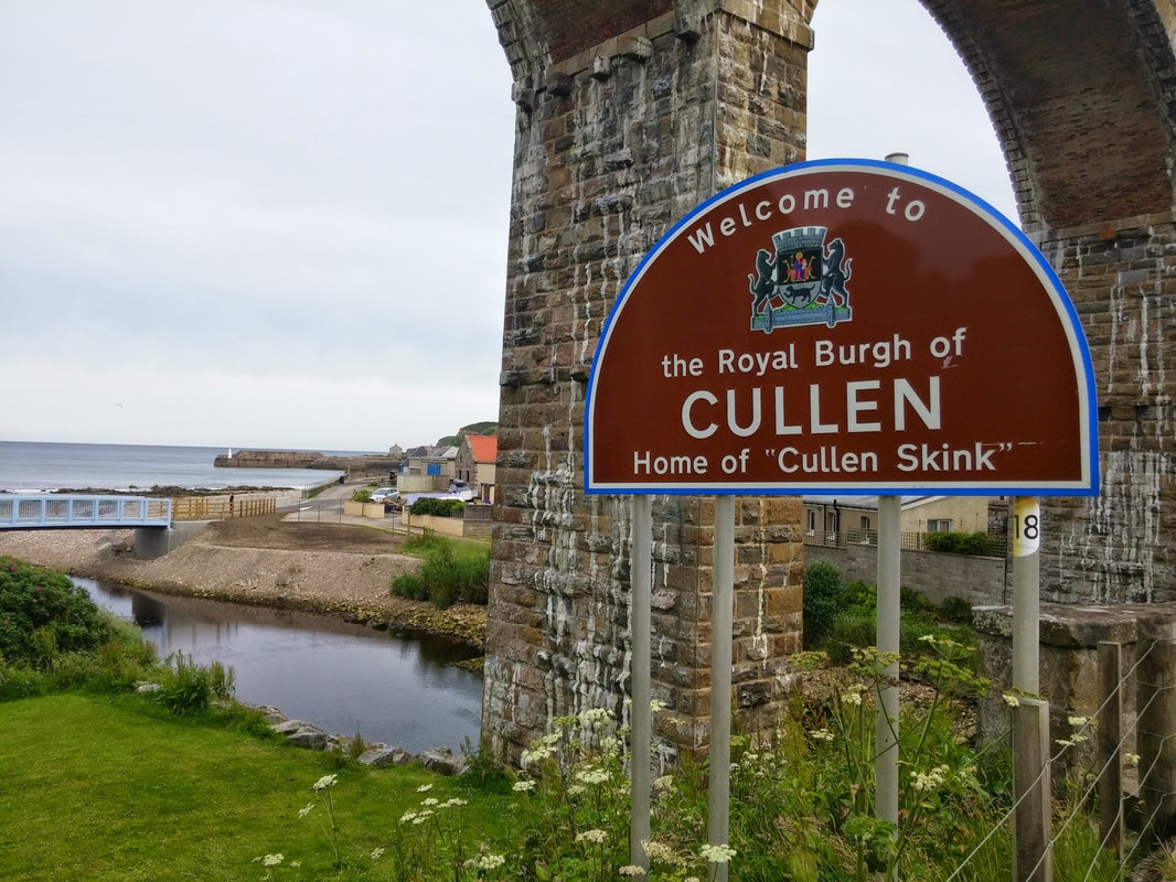 A sign stating 'welcome to the Royal Burgh of Cullen, Home of Cullen Skink'