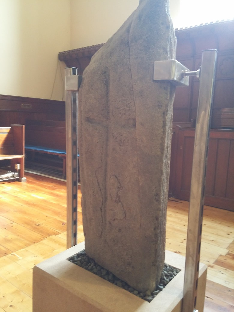 A upright stone slab with carved cross